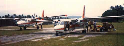 A Twin Otter and an Islander planes on the Norsup Airstrip.