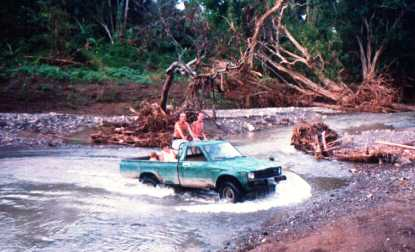 4WD Pickup crossing river.
